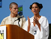 Onstage at Comic-Con, Olivia Munn works her best Princess Leia buns.