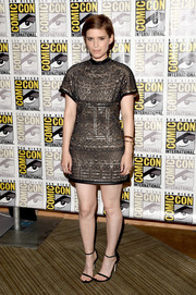 Kate Mara looked breathtaking during Comic-Con in a Valentino beaded mini dress in sheer black with a nude underlay.