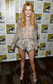 Bella Thorne contrasted her demure top with thigh-flaunting shorts in the same print.