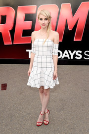 Emma Roberts looked effortlessly chic in a grid-print off-the-shoulder dress by Line & Dot during Comic-Con.