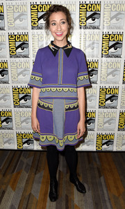 Kristen Schaal tied her look together with a pair of black lace-up boots.