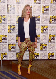 Cara Delevingne teamed lace-up heels with camo pants and a black blazer (all by Dsquared2) for Comic-Con International 2016.