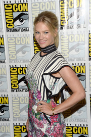 January Jones paired a gold bracelet watch with a cute floral romper for Comic-Con International 2016.