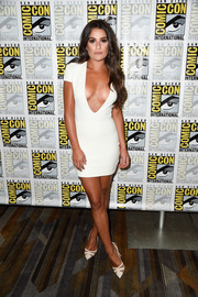 Lea Michele matched her sexy dress with white cutout pumps by Salvatore Ferragamo.