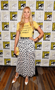 Emma Ishta celebrated girl power with this 'Never underestimate the power of a woman' T-shirt at the Comic-Con press line for 'Stitchers.'