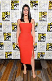 Emeraude Toubia cut a sleek, sexy silhouette in a form-fitting scarlet dress with spaghetti straps and a high side slit during Comic-Con International 2017.