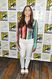 Chelsea Peretti attended the Comic-Con International 2018 'Brooklyn Nine-Nine' press line wearing a colorful sheer blouse.