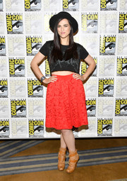 Katie McGrath teamed her shirt with a red knee-length skirt.