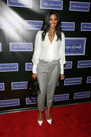Rachel Roy paired her of the moment gray trousers with white pointy pumps.