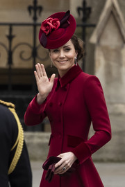 Kate Middleton paired a flower-adorned crimson hat by Sally-Ann Provan with a matching Catherine Walker coat for the 2020 Commonwealth Day Service.