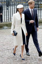 Meghan Markle looked impeccable in a tailored white coat by Amanda Wakeley at the Commonwealth Day service and reception.