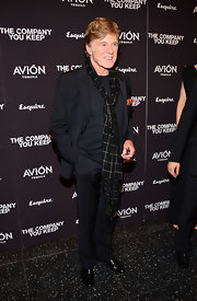 Robert Redford stuck to his signature simple look when he chose this black suit paired over a black sweater.