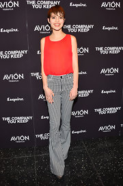 Sami Gayle opted for a vibrant gathered tank to pair with her black-and-white striped pants for a cool retro-inspired look.