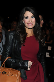 Kimberly Guilfoyle layered a black croc-embossed leather jacket over a red dress for a perfectly polished look.