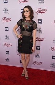 Cristin Milioti paired her cute dress with simple tan ankle-strap heels.