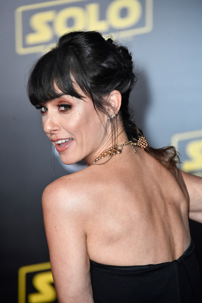 Constance Zimmer French Braid [solo: a star wars story,hair,shoulder,hairstyle,chin,black hair,joint,dress,premiere,neck,eyelash,arrivals,constance zimmer,el capitan theatre,los angeles,california,lucasfilm,disney pictures,premiere,premiere]