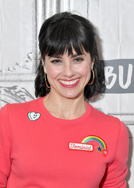 Constance Zimmer Half Up Half Down [show,unreal,hair,hairstyle,bangs,smile,brown hair,black hair,t-shirt,constance zimmer,celebrities,new york city,build studio]