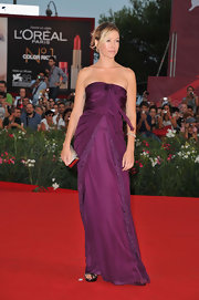 Sarah Felberbaum dazzled on the red carpet in an eggplant gown with a pleated bodice and lace detailing.