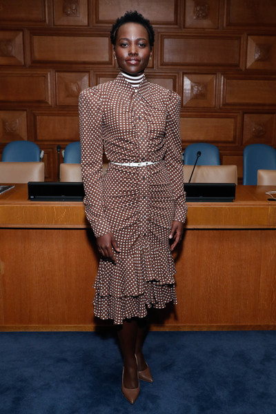 Tan pumps by Kahmune completed Lupita Nyong'o's monochromatic look.