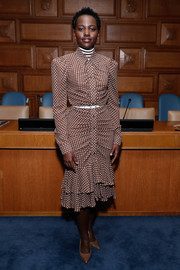Lupita Nyong'o chose a ruched brown polka-dot shirtdress by Michael Kors for the World Food Programme event.