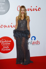 Natasha Poly attended the Convivio 2016 photocall wearing yet another sheer gown, this time a gray Roberto Cavalli number featuring sparkly embellishments and a feathered midsection.