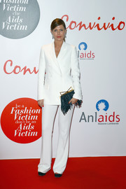 Sara Battaglia attended the Convivio 2016 photocall wearing a crisp white pantsuit.