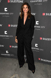 Cindy Crawford kept it simple yet stylish in a black pantsuit at the Cosentino LA City Center grand opening.