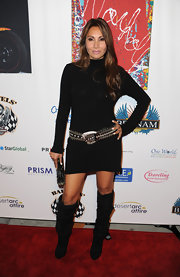 Wedi David added some spice to her look with suede knee high boots.