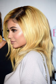 Kylie Jenner went blonde (with dark roots) for Cosmopolitan's 50th birthday celebration.