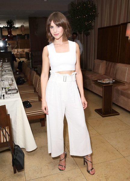 Alison Brie gave her casual look an elegant finish with a pair of strappy silver heels.