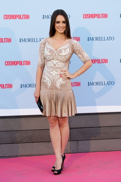 Alicia Sanz wore this nude-colored dress that featured cream embroidered details and a pleated dropped skirt.