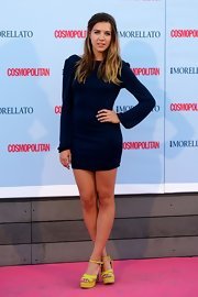 Andrea kept her look simple and chic with a long-sleeve deep navy dress.