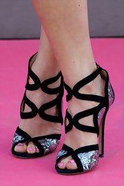 Juana Acosta showed off her pretty pink pedi with this pair of black and silver sequined evening sandals.
