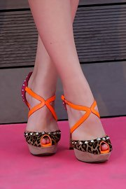 Andrea Duro opted for vibrantly colored strappy platform sandals.