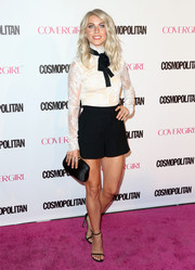 Julianne Hough looked cute on the pink carpet in a fitted white lace blouse by Femme D'armes during Cosmopolitan's 50th birthday celebration.