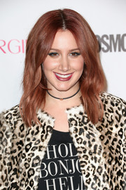 New redhead Ashley Tisdale wore her wavy hair parted down the middle for Cosmopolitan's 50th birthday celebration.