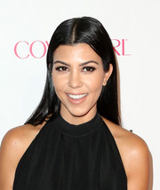 Kourtney Kardashian sported her usual straight center-parted style when she attended Cosmopolitan's 50th birthday celebration.