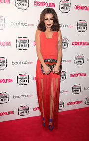 Cher Lloyd upped the glamour of her unusual fringed dress with a sequined purple and red clutch.