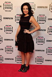 Kelly Brook donned black mesh peep toe booties at the Cosmopolitan Ultimate Woman of the Year Awards. She paired the fresh heels with a low-waisted Azzedine Alaia dress.
