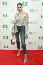Olivia Culpo attended the Blue Jeans Go Green 10th anniversary celebration looking frilly in a striped gray ruffle blouse by Zimmermann.