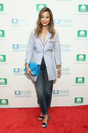 Jamie Chung injected a bright pop of color with a turquoise envelope clutch.