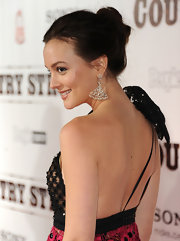 Leighton Meester finished off her elegant updo with classic diamond dangling earrings. Minimal makeup was the perfect finishing touch.