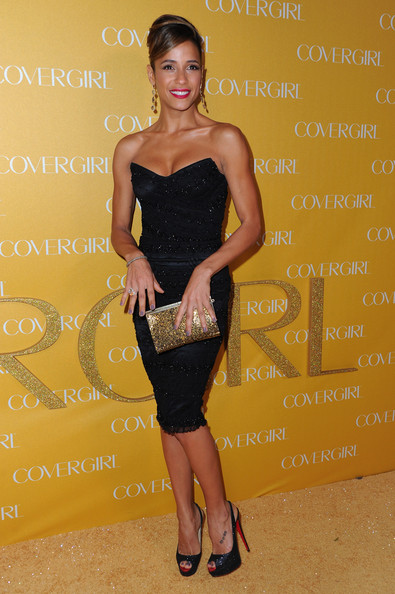 Dania Ramirez gave her vixenish look extra glamour with a gold sequined clutch.