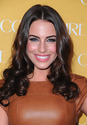 Jessica Lowndes styled her brunette locks in soft medium curls. A modern center part completed her look.