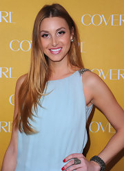 Whitney Port added a pop of color to her look with sparkling pink lips.