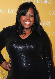 Amber Riley curled her raven locks to create a bit of bounce and volume. Perfect!