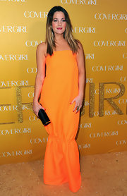 Actress Drew Barrymore attended CoverGirl Cosmetics 50th Anniversary party wearing an 18-karat gold Vene ring.