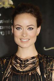 Olivia Wilde paired her statement Gucci dress with simple gold stud earrings.
