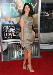 Marisa Tomei looked glam at the 'Crazy, Stupid, Love' premiere in dark beige sculpted dress with t-strap heels. She completed the look with a vibrant bracelet by David Webb.