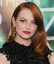 Emma Stone wore a stunning Tom Ford dress that she paired with elegant diamond tassel earrings from Fred Leighton.